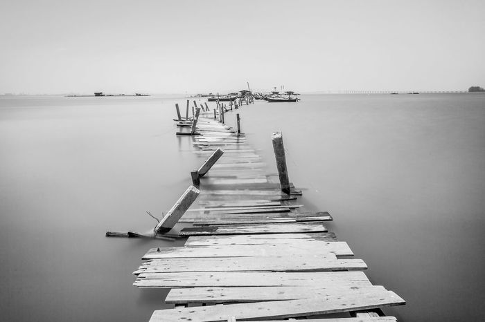 Overflow broken wooden bridge view Classic Overflow Print Beauty In Nature Blacckandwhite Black And White Bridge Clear Sky Day Harbor Horizon Over Water Jetty Moored Nature Nautical Vessel No People Outdoors Pier Scenics Sea Sky Tranquil Scene Tranquility Village Water Wood - Material Wooden