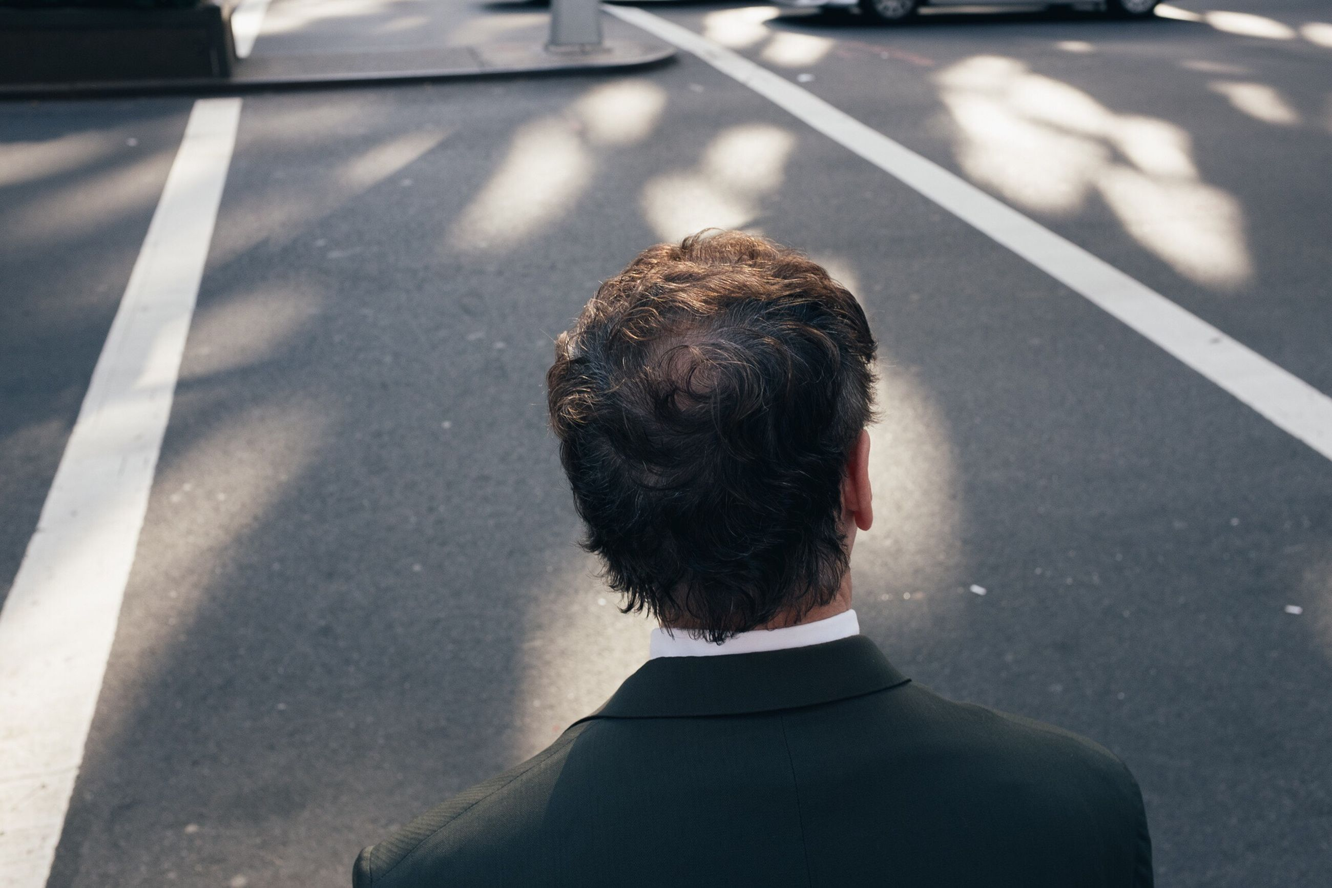 rear view, real people, high angle view, road, day, sunlight, outdoors, headshot, one person, shadow, men, adult, people