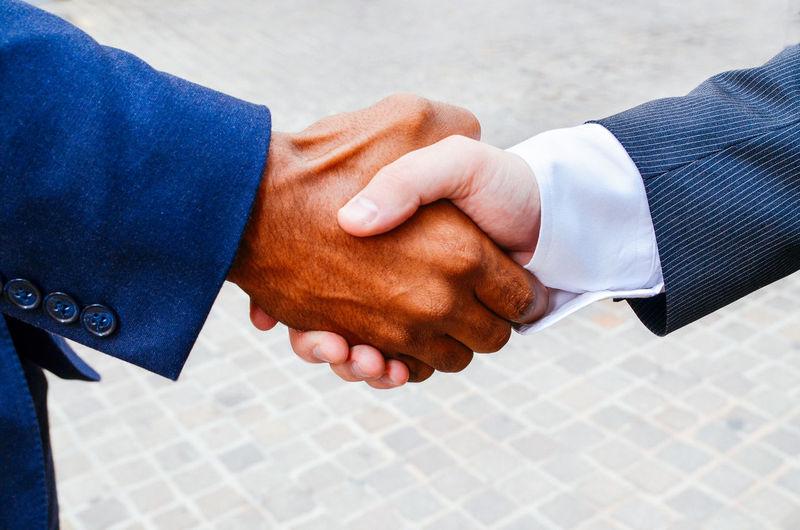 Close-Up Of Men Doing Handshake Outdoors