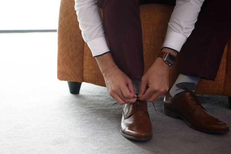 it's time Tying Adult Front View Hand Human Body Part Human Hand Human Leg Indoors  Leather Lifestyles Low Section Real People Shoe Shoelace Sitting Well-dressed