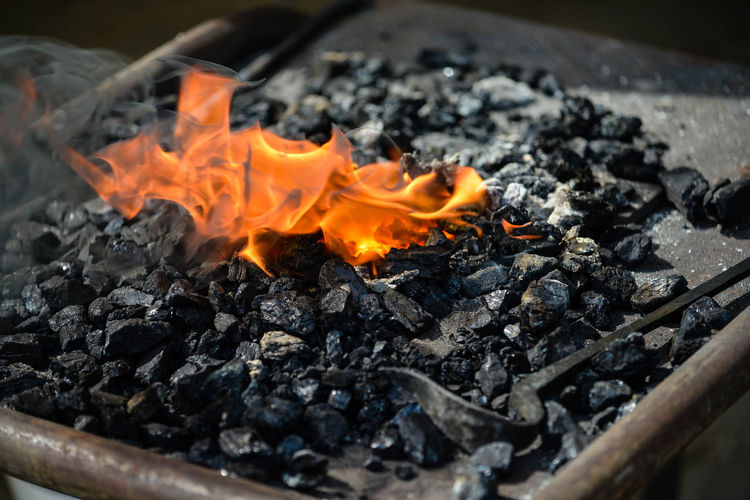 Close-up of bonfire on wood