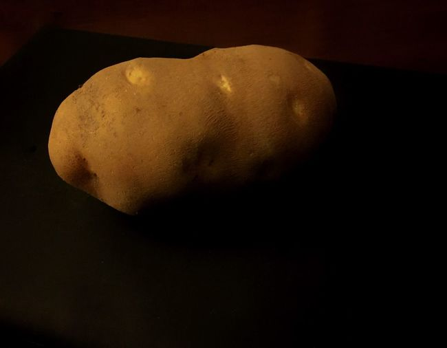 Russet potato in stark relief. Looking forward to a good bake and some butter. Potato Russet Potatoes No People Asteroid Astronomy Black Foreground Agriculture Farm Baked Potato Food Produce Garden