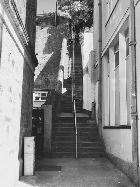 Step up Streetphoto Street Light Exceptional Photographs Where Do They Lead? Travel And Tourism Travelphotography Buildings Architecture Walls Architecture Streetphotography Blackandwhite Windows Day Outdoors Cornwall Railing Steps And Staircases Building Exterior Built Structure Stairs To Where? EyeEmNewHere The Week On EyeEm