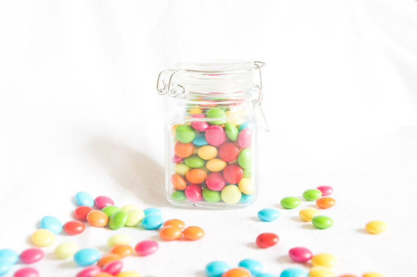 jar filled with smarties, colorful sweets Birth Candy Close-up Color Colorful Colorful Candy Colorful Sweets Jar Large Group Of Objects Multi Colored Smarties Studio Shot Sweet Food Sweets White Background