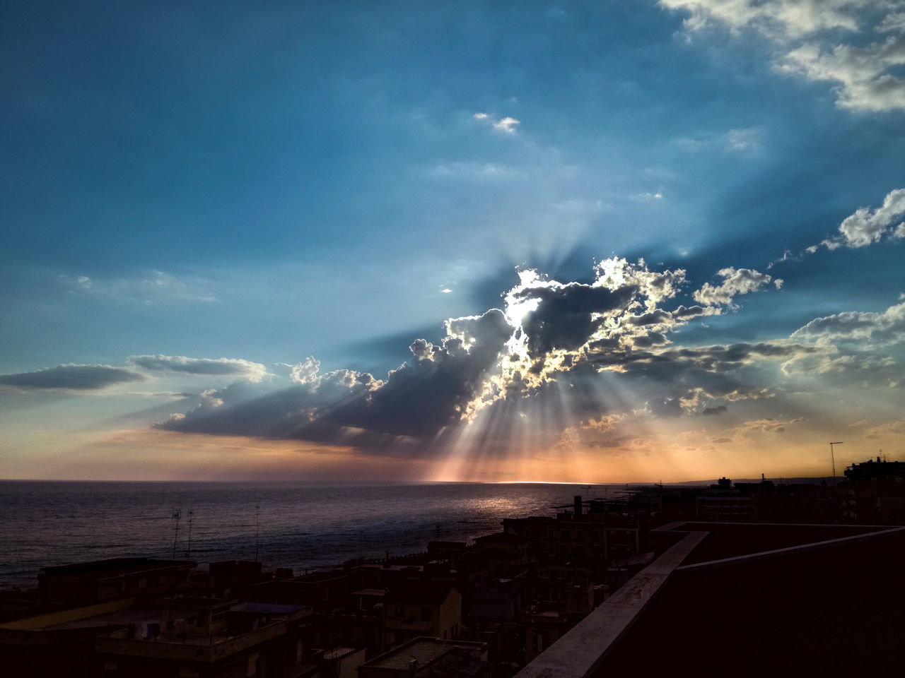PANORAMIC VIEW OF CITY AT SUNSET