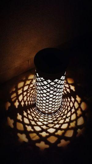 High Angle View Of Illuminated Lantern In Darkroom