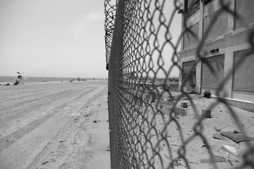Riis Beach Beach Day Fence Fujifilm_xseries FujifilmX_US Metal Nature New York City No People Outdoors Photographyisthemuse Sand Sea Sky Water Barbed Wire Summer Travel Photography Travel Destinations