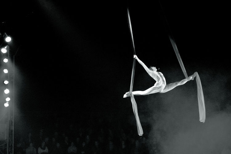 Circus scene Trapeze Artist Circus Magic Melancholy Blackandwhite Grazing Air Public Black Background Close-up