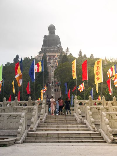 Religion Steps Steps And Staircases Spirituality Flag Architecture Staircase Built Structure Ancient Place Of Worship Men History Day Sky Outdoors Travel Destinations Building Exterior Large Group Of People Statue Real People Buddha HongKong Hongkong Photos Hongkongphotography