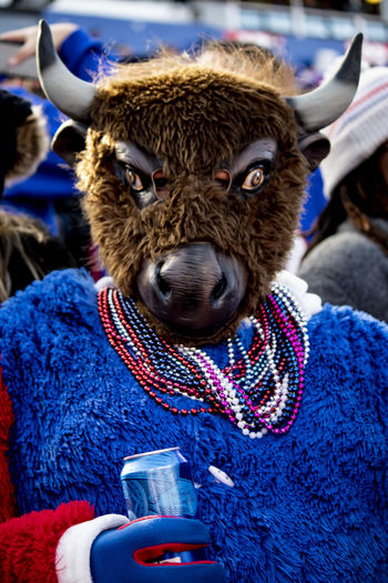 "Bills ""Mafia"" alive and well in Bills losing streak Drink Portrait Mammal Clothing Refreshment Looking At Camera Food And Drink Winter People Focus On Foreground Blue Front View Day Warm Clothing Hat Cup Drinking Buffalo,ny Bills Fan - Enthusiast EyeEm Best Shots NFL Football Veterans Memorial This Is Strength"