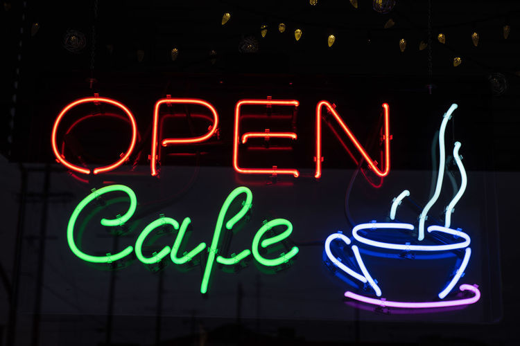 neon sign in window of coffee shop or coffee house on an early rainy morning in Bishop, California, USA Illuminated Neon Text Communication Sign Western Script Lighting Equipment Night Glowing Restaurant Food And Drink No People Red Cafe Bar - Drink Establishment Drink Information Close-up Business Dark Light Glass Store Sign Coffee Cup Coffee Shop