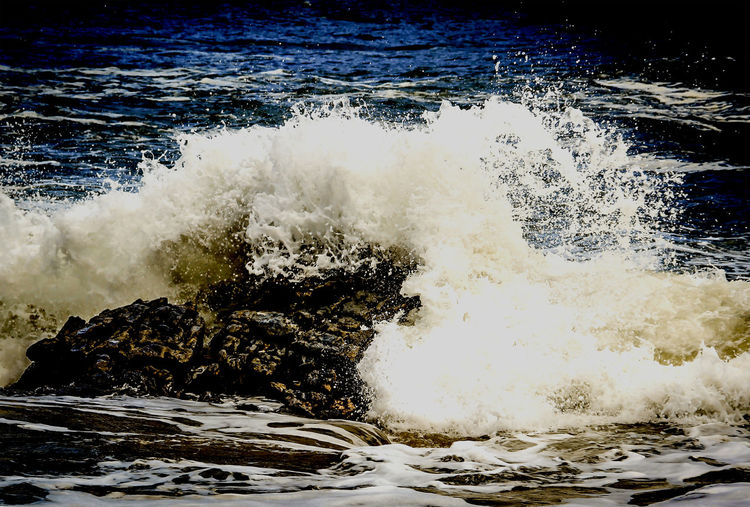 Beach Beauty In Nature Day Flowing Flowing Water Idyllic Motion Nature No People Non-urban Scene Outdoors Power In Nature Remote Rock Scenics Splash On The Rock Splashing Tranquil Scene Tranquility Travel Photography Water Wave Wave Wave On The Rock Weather