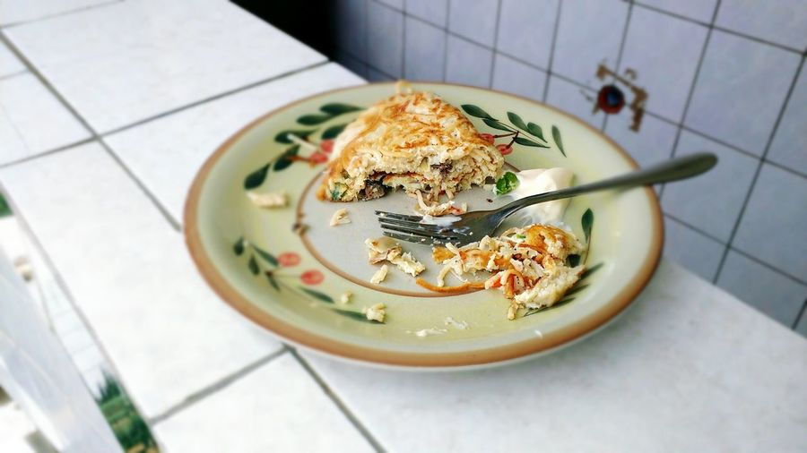 Food served in plate on kitchen island