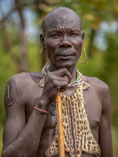 Tribe Africa Ethiopian Photography 🇪🇹 Ethiopia African Ethiopian Portraits Omo Valley Portrait Photography Tribal Tribes Mursi Mursi Village Focus On Foreground Day Portrait People Adult Front View Arts Culture And Entertainment Lifestyles Outdoors Human Representation Waist Up Real People Art And Craft Leisure Activity Close-up Land Nature