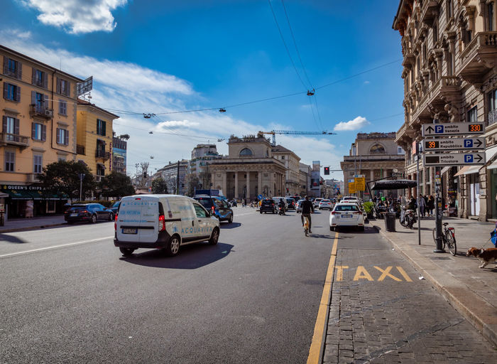 City Building Exterior Architecture Transportation Street Built Structure Motor Vehicle Mode Of Transportation Car Road Sky Cloud - Sky Nature Land Vehicle Building Incidental People Direction Symbol City Street City Life Outdoors Porta Venezia, Milano