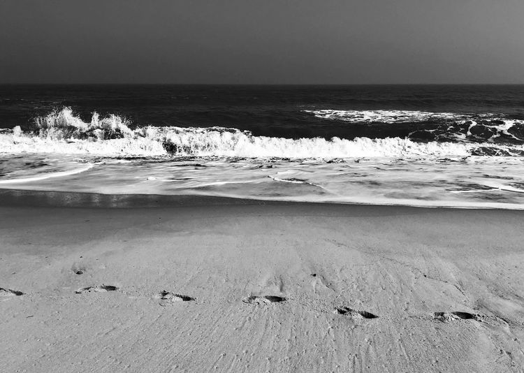 Leave only footprints Black And White Photography Blackandwhite Photography Black & White Black And White Blackandwhite Eyem Best Shots Nature_collection Eyemphotography EyeEm Nature Lover Copy Space Footprints In The Sand FootPrint Beach Sea Water Horizon Over Water Beauty In Nature Scenics - Nature No People Motion Sand Sky