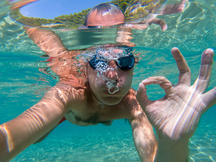 Sea underwater selfie shot of a swimmer with water bubbles Swimming Leisure Activity Water Man Males  Sea Eyewear UnderSea Swimming Underwater Ocean Sea Water Blue Transparent Air Bubbles Snorkeling Fun Healthy Lifestyle Summer Vacation Tropical Tropical Paradise Thailand Maldives Phi Phi Island Underwater Selfie