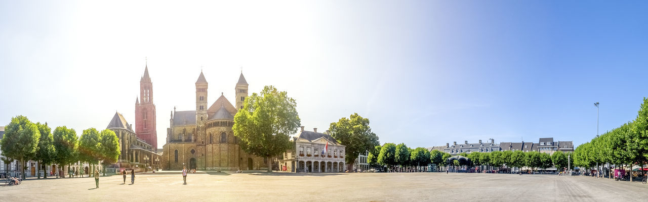 Panoramic view of trees and buildings against clear sky