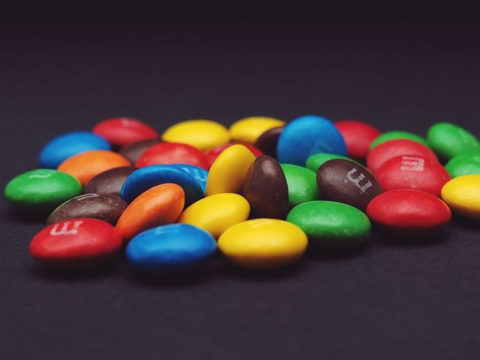 Close-up of colorful candies against black background