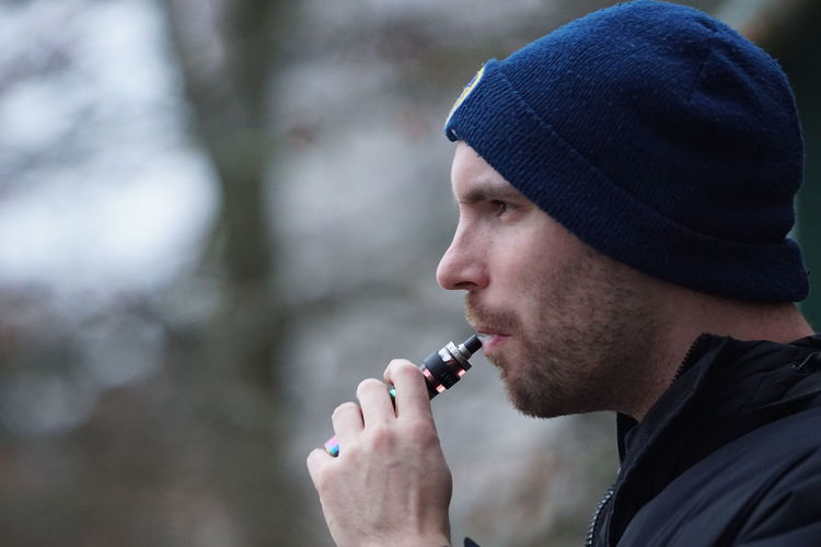 Man Vaping Headshot Side View Close-up Bad Habit Unhealthy Living British Culture