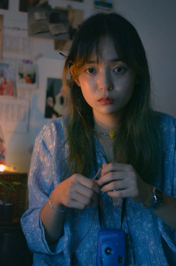 Portrait of beautiful young woman wearing mask