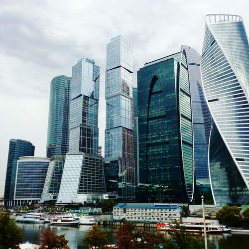 Skyscraper Architecture City Modern Downtown District Cityscape City Life Building Exterior Cloud - Sky Sky Office Building Exterior Urban Skyline No People Outdoors Illuminated Day Moscow City