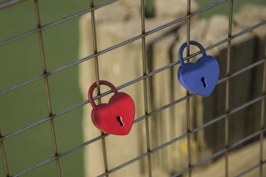 Padlocks Blue Close-up Coastline Day Enjoying Life Fishing Padlocks Hanging Love No People Outdoors Pier Protection Red Red And Blue Safety