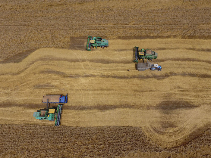 High angle view of tractors on field