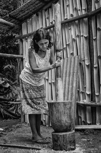Avaxi. Indian Nature Rio Silveira Indian Reservation Travel Photography Adult Aldeia Guarani Alimento Black And White Food Guarani Corn Guarani Indian Guarani Village Guarani Woman Indigenous Culture Indigenous Reservation Indio Guarani Milho Guarani One Person Outdoor Pau De Pilao Praia De Boraceia Pretoebranco Real People Reserva Indigena Rio Silveira Wood - Material