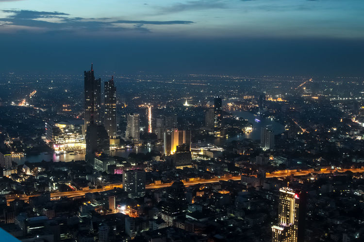 Thai City scape night Building Exterior Architecture Cityscape City Built Structure Illuminated Building Sky Crowd Night Skyscraper Office Building Exterior Cloud - Sky Crowded Tall - High Nature Modern Tower Travel Destinations Outdoors Financial District  Spire  Cityscape City Scape City Scape Night