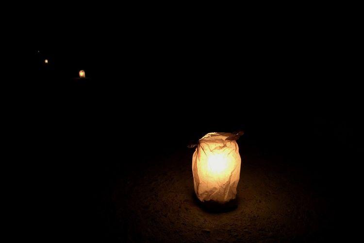 Close-up of illuminated lamp in darkroom
