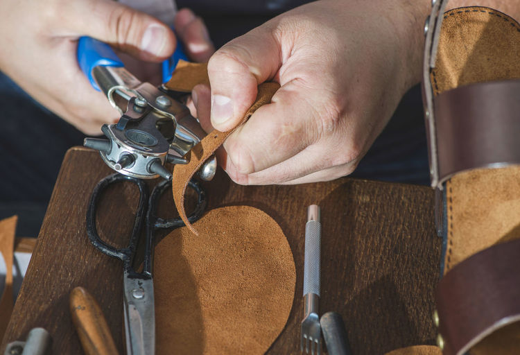 Shoes Shoemaker Craft Leather Hands Handmade Work Tools Human Hand Hand One Person Real People Holding Human Body Part Indoors  Metal Close-up Men Working Body Part Unrecognizable Person Focus On Foreground Finger Occupation Human Finger Skill  Day