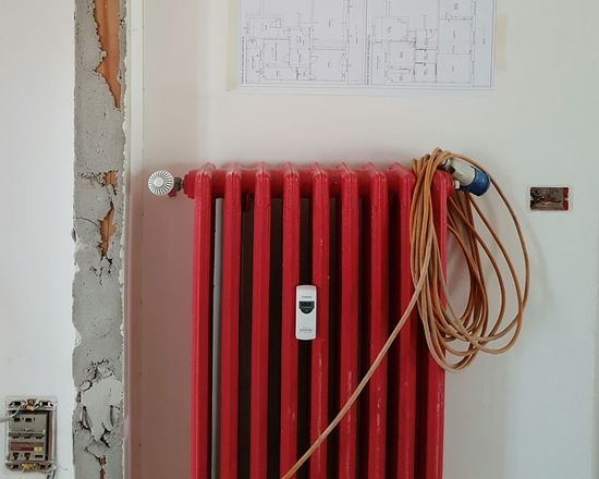 Red No People Indoors  Close-up Radiator Day Electric Wires Elctricity Work Area Remodelinghome Home Improvements Interior Renovation Work In Progress Home Building Architecture Home Interior Edils Electricity  Connection Home Renovation  Home Refurbishing Construction Industry Rebuilding Electrical Equipment Workinprogress EyeEmNewHere