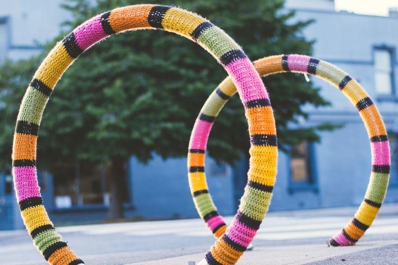 Colorful bicycle rack on street against buildings