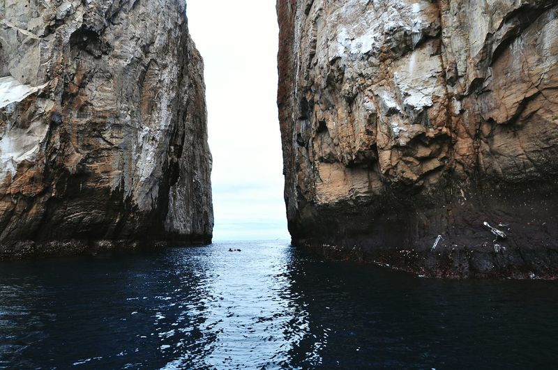 Scenic View Of Rock Formation In Sea At Galapagos Islands