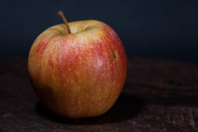Close-up of apple on black background