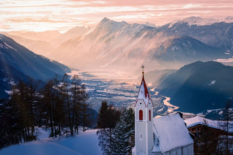 Church against mountains during winter