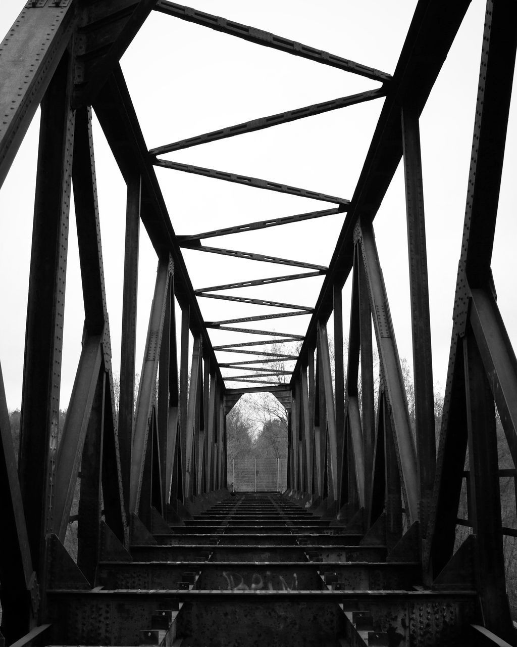 LOW ANGLE VIEW OF BRIDGE AGAINST SKY IN BACKGROUND