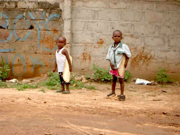 Two Boys Child Brick Wall Two People Males  Full Length Fun Outdoors City Friendship People Togetherness Childhood Day Human Body Part African People Real People