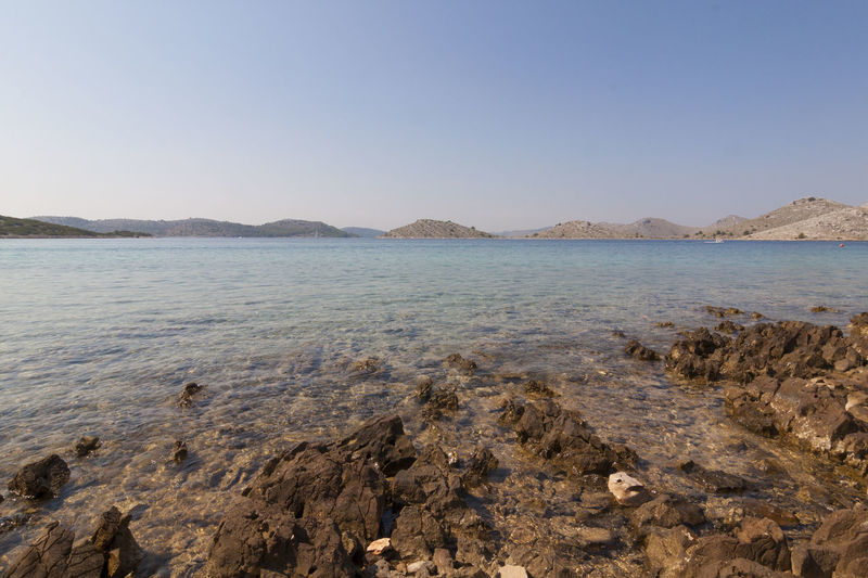 Looking out to sea from one of the Kornati Islands, Croatia. Beach Sea Sand Outdoors Nature Sky Tranquility No People Scenics Day Clear Sky Water Low Tide Beauty In Nature Zadar Croatia Vacations Kornati Park National Landscape Water's Edge