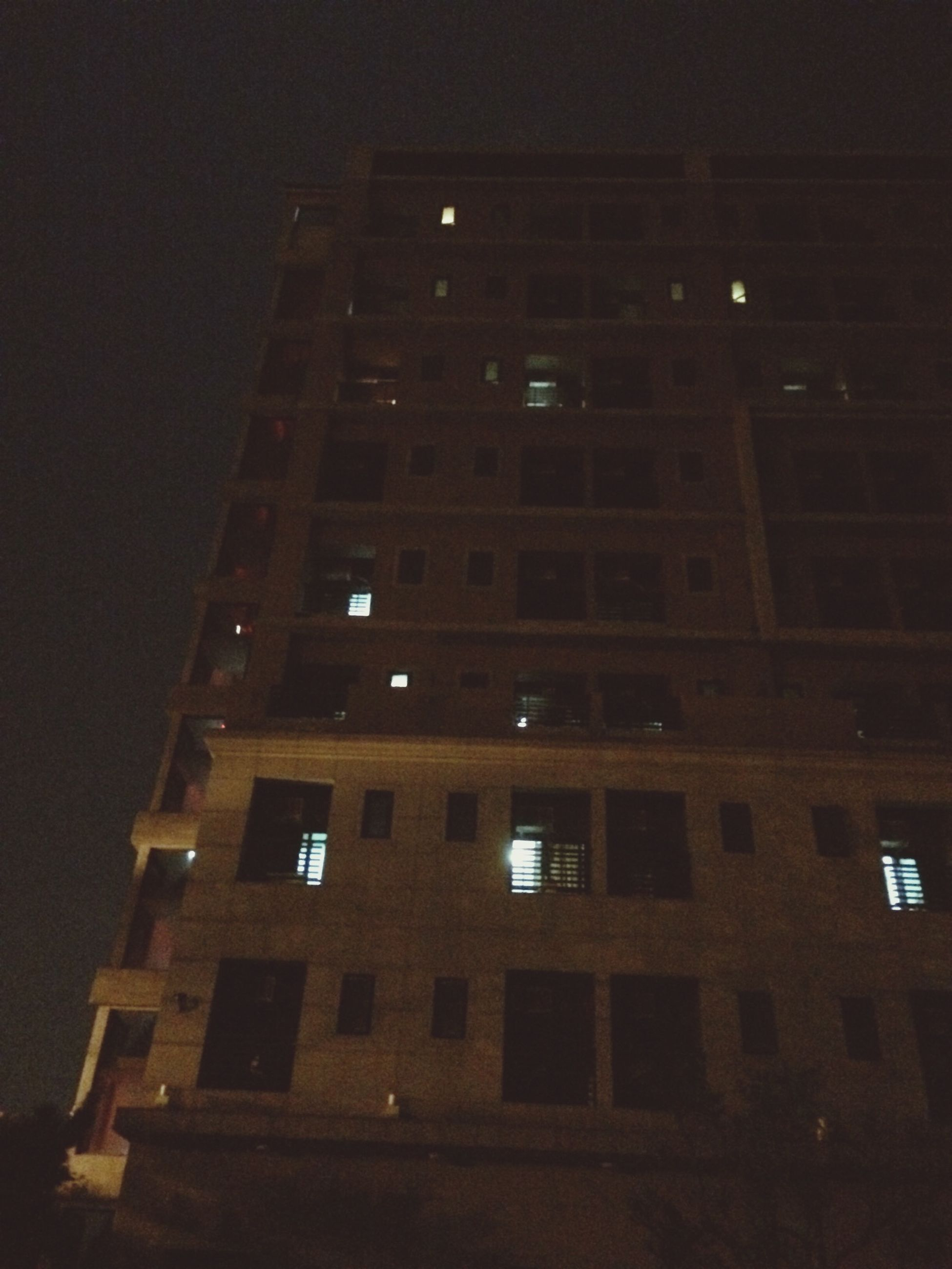 architecture, built structure, building exterior, low angle view, night, illuminated, building, window, city, sky, residential building, no people, outdoors, modern, residential structure, office building, tower, exterior, tall - high, clear sky