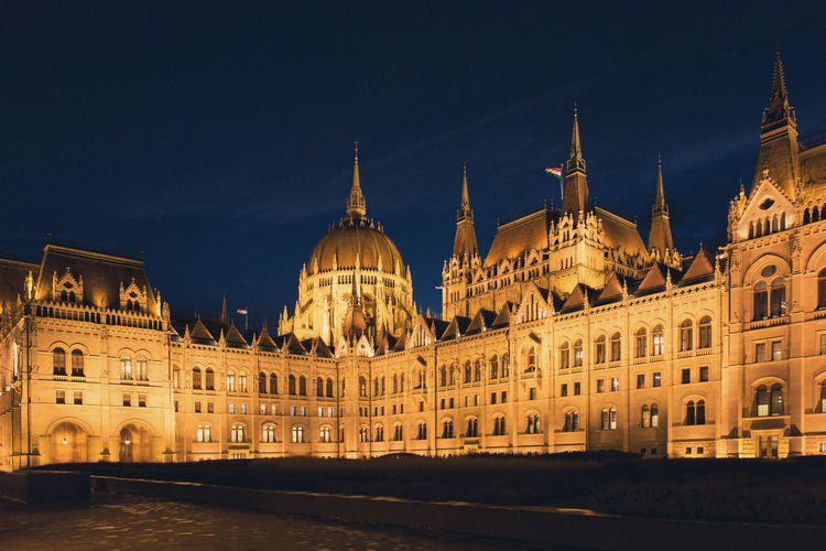 Budapest Parliament at night illuminated at Christmas Architecture Budapest Building Capital City Christmas christmas tree Danube Decoration Europe Evening Fair Famous Place Garlands Gothic Government Hungary Illuminated Winter Travel Tourism Night Parlament Parliament Lamps Urban