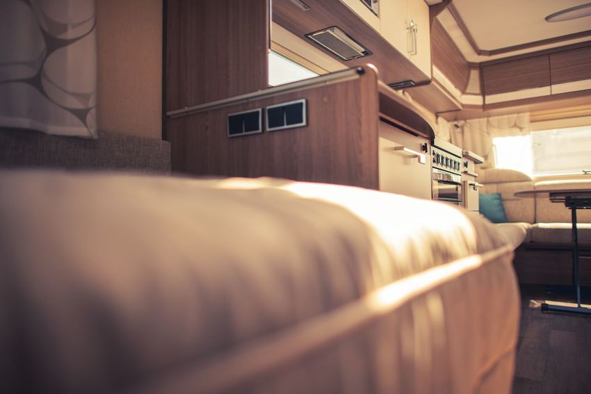 Recreational Vehicle Elegant Interior. Camping Theme. Bed Rving Travel Absence Bed Bedroom Building Built Structure Camper Domestic Room Furniture Home Home Interior Hotel Indoors  Luxury No People Pillow Rv Selective Focus Travel Trailer Wealth