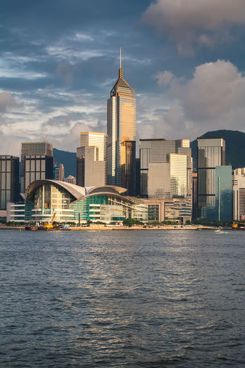 Cityscape and Beautiful sunset over the Victoria bay in Hong Kong, China HongKong Hong Kong Skyline City Building China Harbor Victoria Harbour Business Business Finance And Industry ASIA Travel Travel Destinations Downtown Skyscraper Skyscrapers Urban Urban Skyline Cityscape Architecture Sky Modern Modern Architecture Landscape Tourism