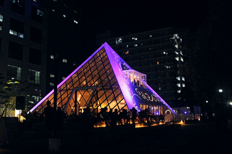 Architecture Arts Culture And Entertainment Building Building Exterior Built Structure City City Life Crowd Group Of People Illuminated Incidental People Large Group Of People Lifestyles Lighting Equipment Low Angle View Nature Night Nightlife Outdoors Real People Sky Stage