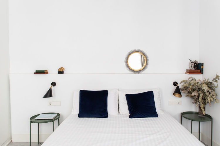Empty seats on bed against wall at home