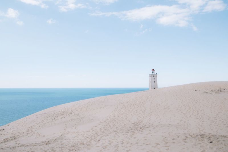 Rubjerg knude lighthouse, clean Beach Sea Sky Water Land Sand Horizon Scenics - Nature Horizon Over Water Nature Tower Tranquil Scene Lighthouse Beauty In Nature Guidance Outdoors