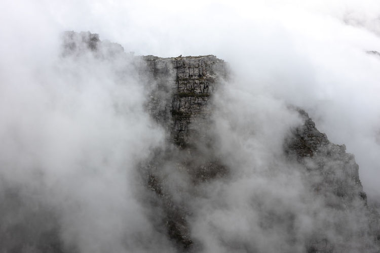 Aerial view of mountain amidst fog