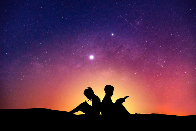 Sky Silhouette Real People Two People Beauty In Nature Togetherness Lifestyles Star - Space Sitting Nature Night Outdoors Friendship Reading Book Hobby Education