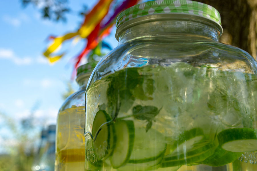glass jar with lemonade Lemonade Bottle Citrus Fruit Close-up Container Drink Drinking Glass Food Food And Drink Fruit Glass Glass - Material Herb Household Equipment Jar Leaf Lime Nature No People Outdoors Pitcher - Jug Refreshment Summer Transparent